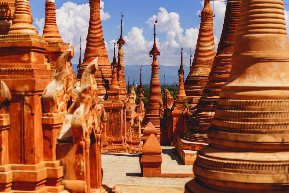 Red stone stupas at the Buddhist shrine of Indein Pagoda in Myanmar