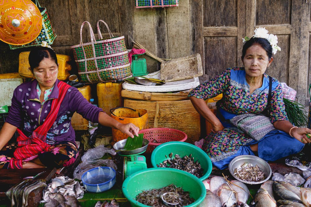 Burmese local Shan state women selling fresh fish and seafood at village market of Nyaungshwe Myanmar