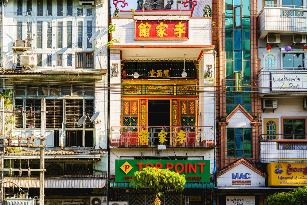 Diversity in culture and architecture among buildings of downtown Yangon with Chinese, English and Burmese signs