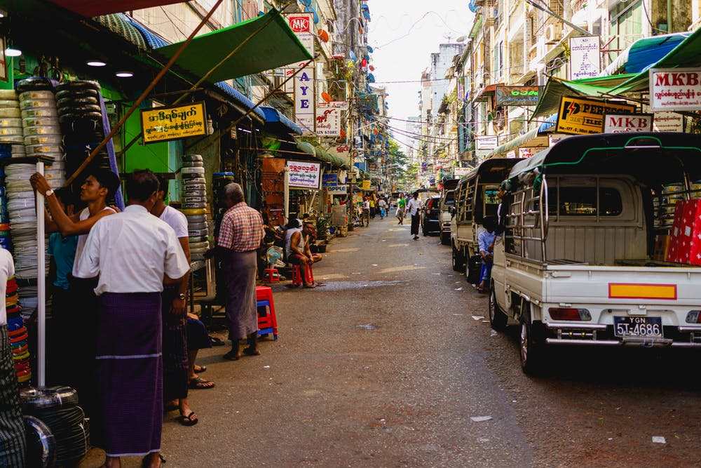 Working-class street scene in Chinatown of Yangon Myanmar where local Burmese people tend to their industrial shops