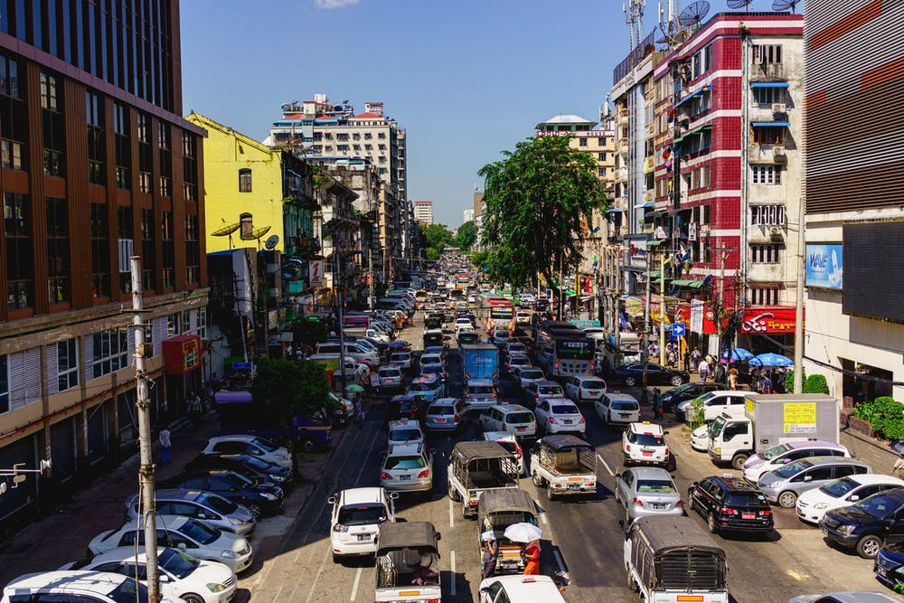 Heavy traffic in downtown Chinatown of Yangon Myanmar on one of the city main roads