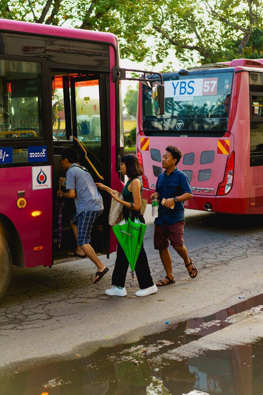 Burmese locals board a public city bus in downtown Yangon Myanmar