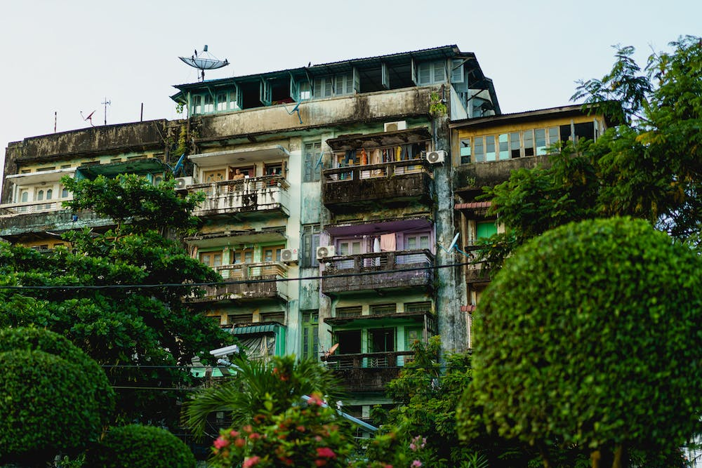 Aging and discolored residential apartment buildings near Chinatown in Yangon Myanmar