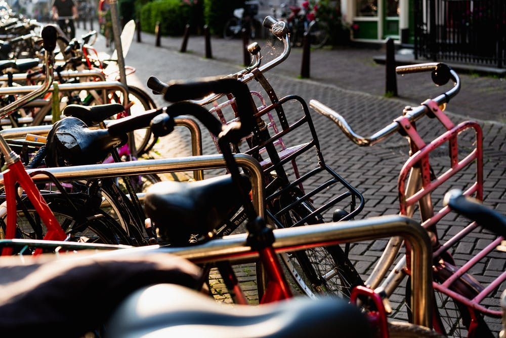 Bikes lined up on a rack in Amsterdam