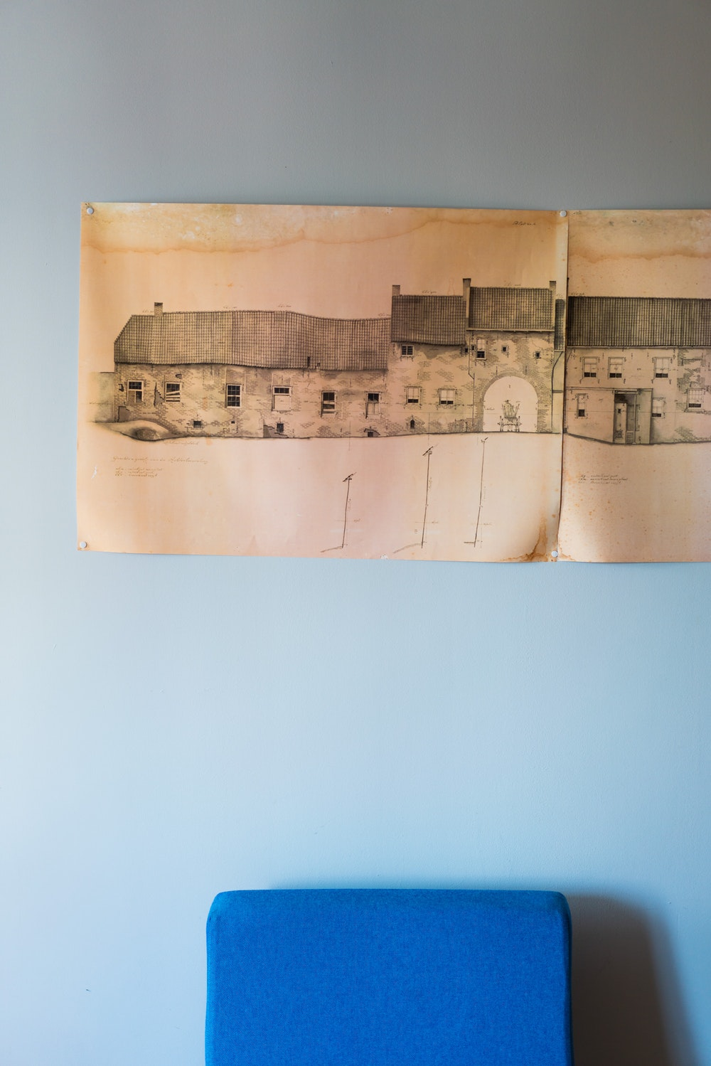 Vintage map wall art in a hotel room