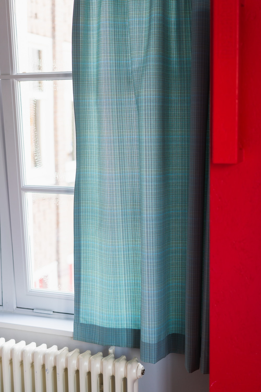 Curtains on a window in a hotel room