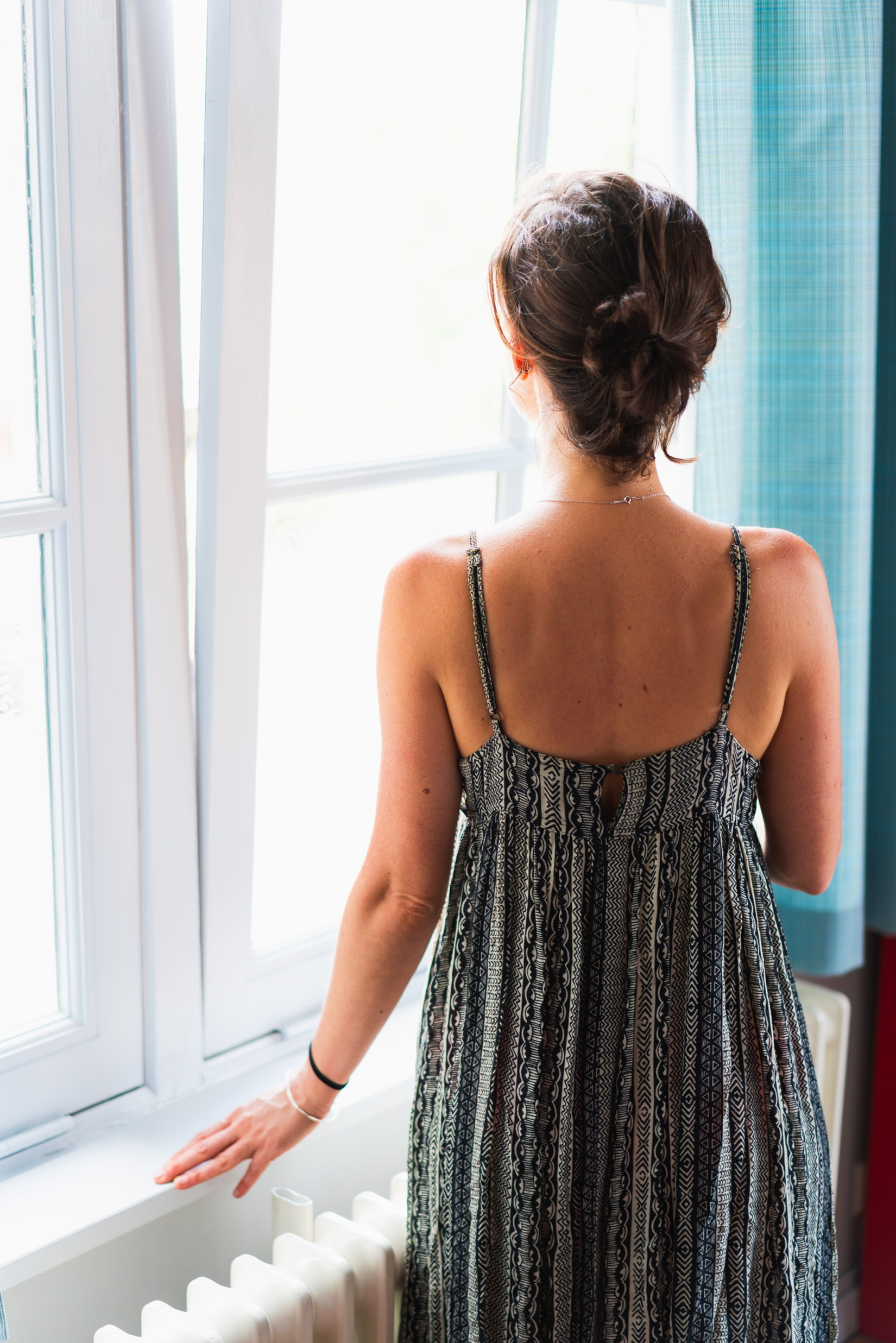 Girl at a window in a hotel room