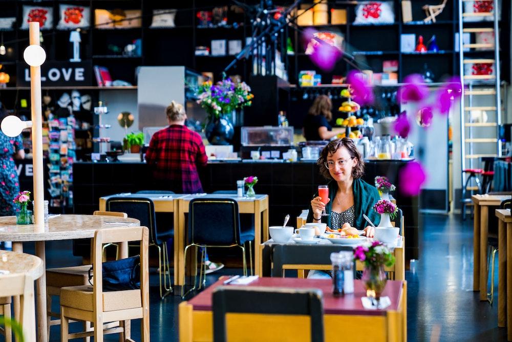 Girl dining in Lloyd Hotel's restuarant