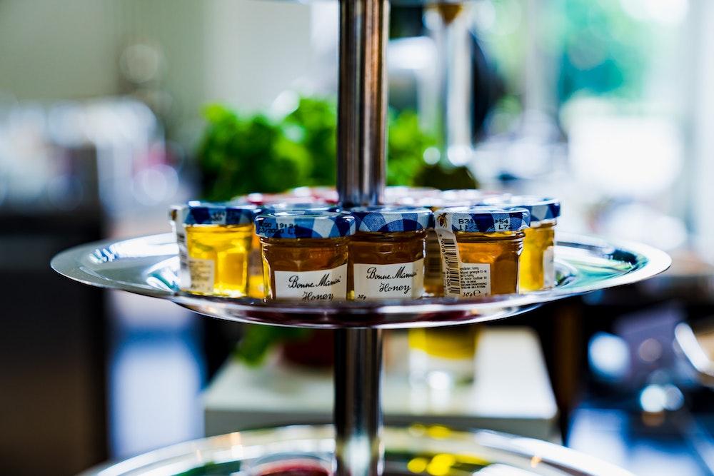 Tiny jars of honey at hotel breakfast