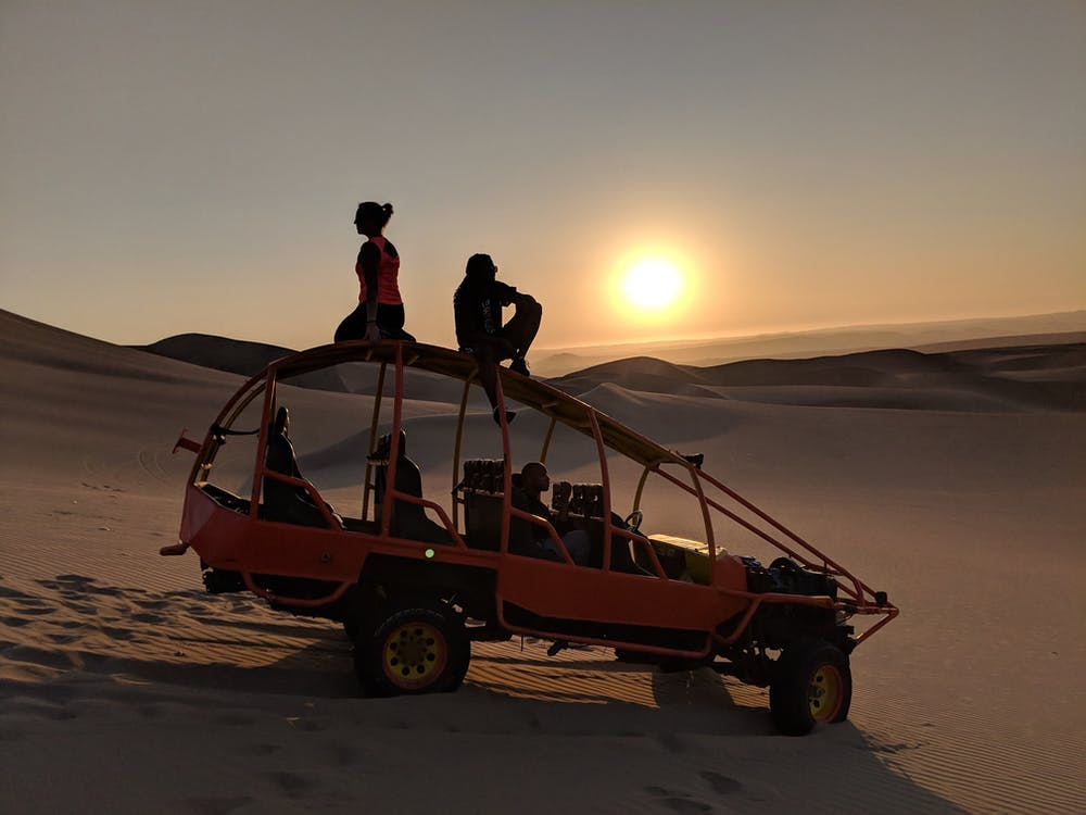 Going sandboarding in Peru is what we thought was a once-in-a-lifetime experience - that is, until we both did it twice! After going sandboarding and dunebuggying, watching the sun set from the top of a dune in the Peruvian desert is awesome!