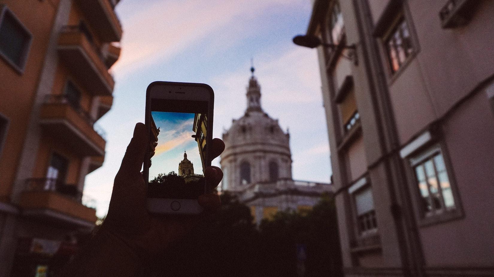 Becca taking a photo of Basilica da Estrela in Lisbon