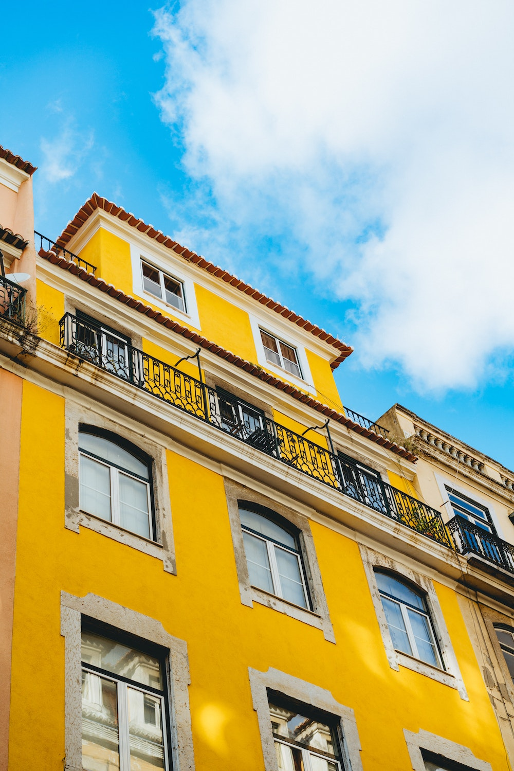 Yellow architecture and reflections near the Alfama in Lisbon, Portugal