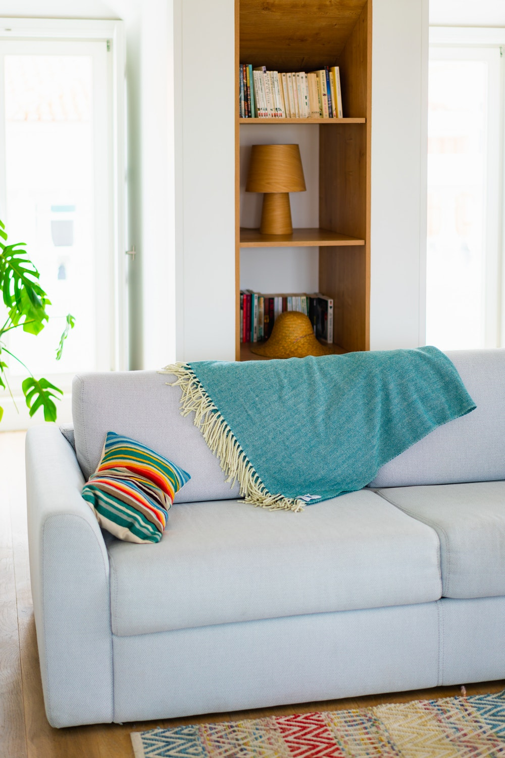 Throw blanket draped over a sofa at The Lisboans in Lisbon, Portugal
