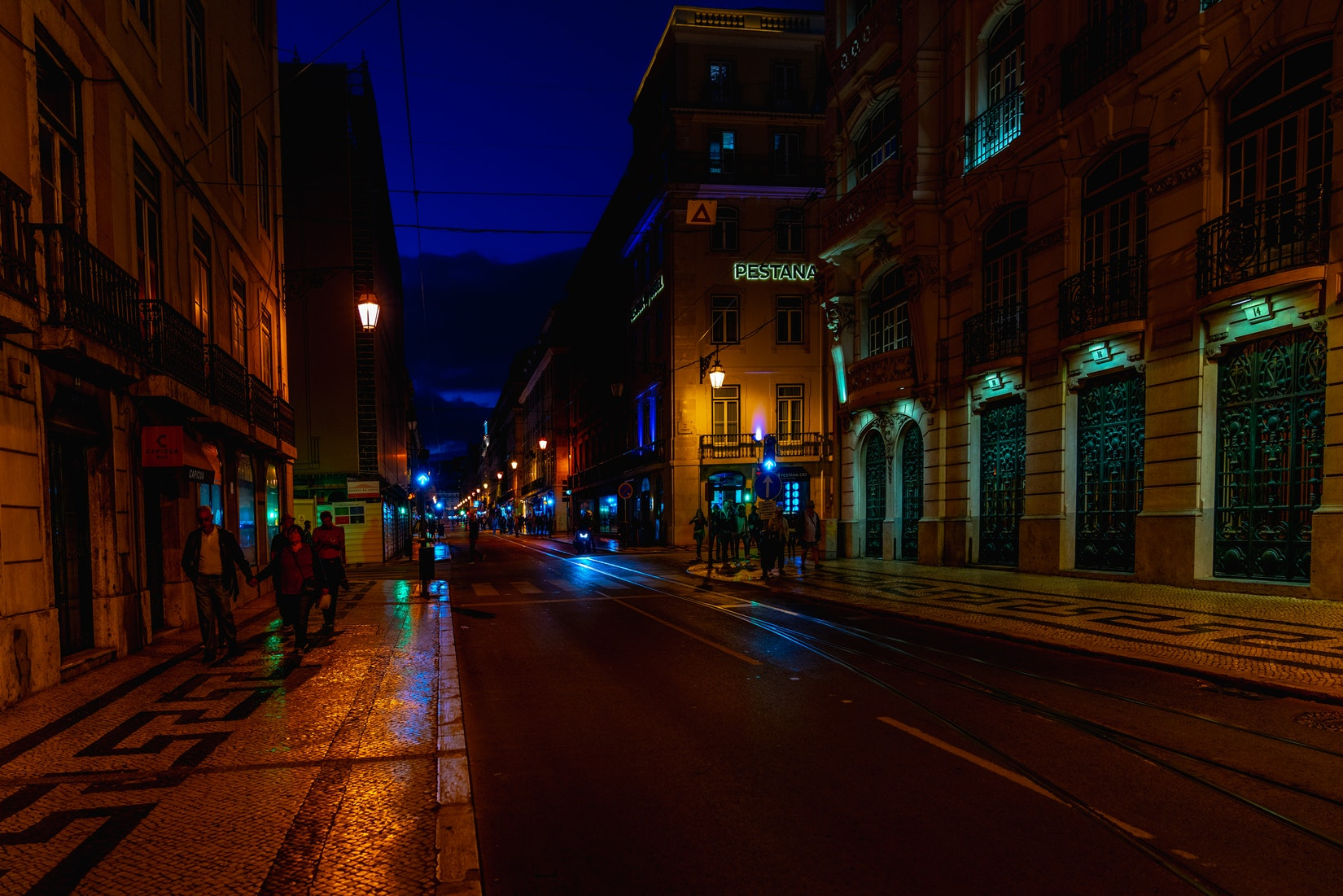 Lights in a night scene on streets of Baixa district in Lisbon, Portugal