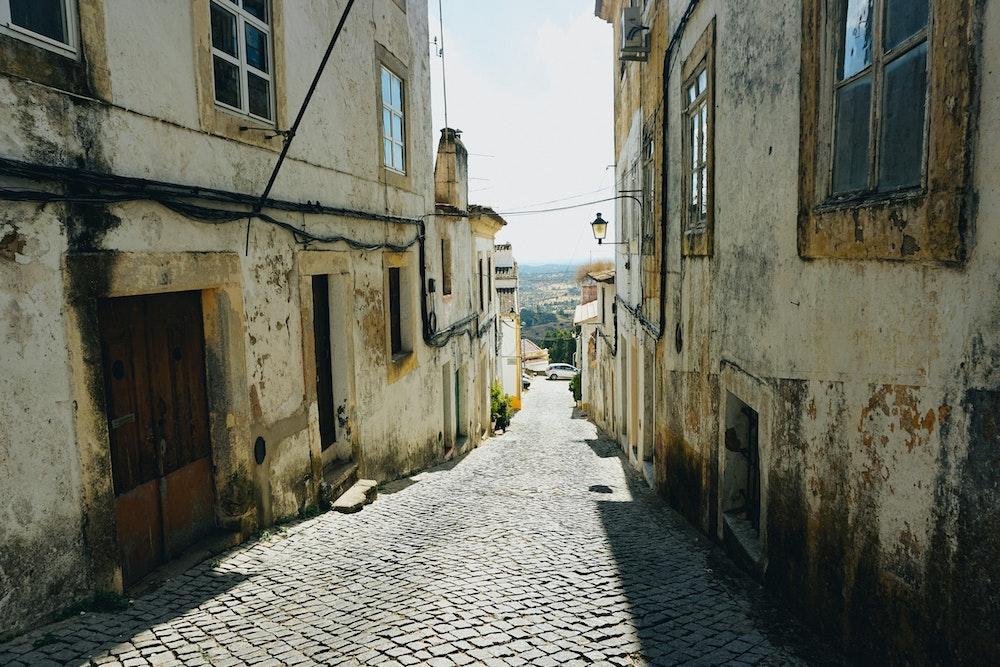 Cobblestone streets leading to views in Portalegre, Portugal