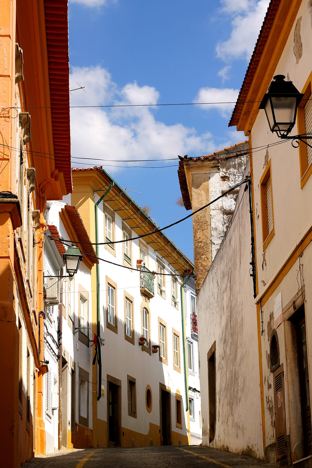 Sunny streets with white and yellow homes in Portalegre