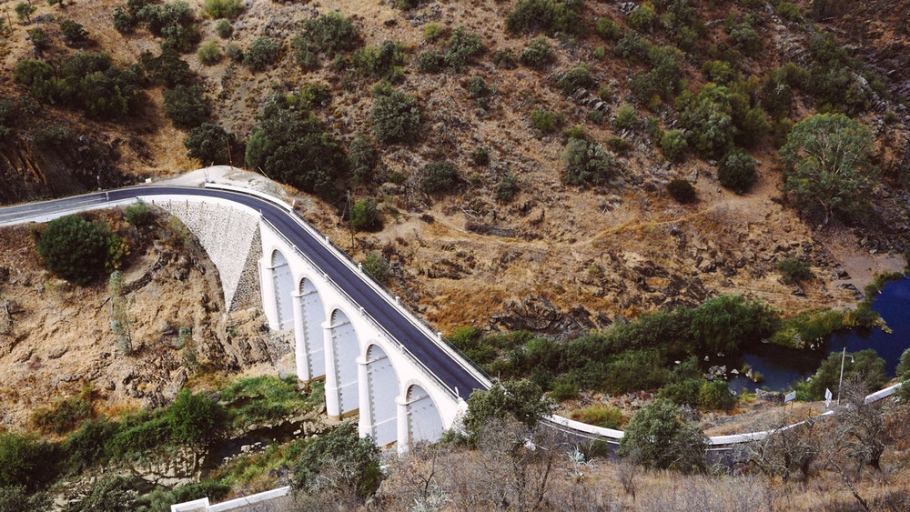 View of a river and driving bridge in Mertola