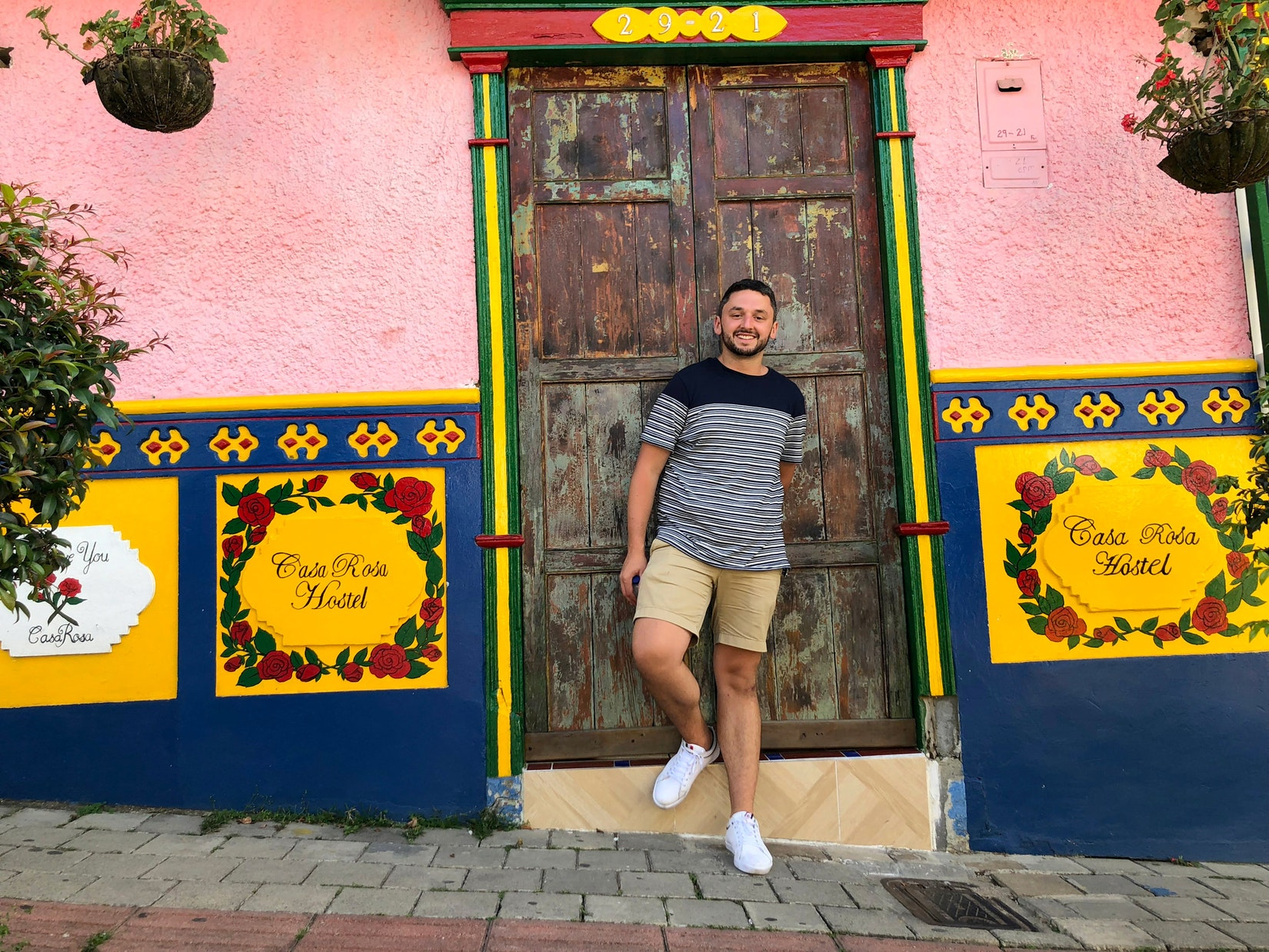 Daniel with colorful walls in Guatape, Colombia