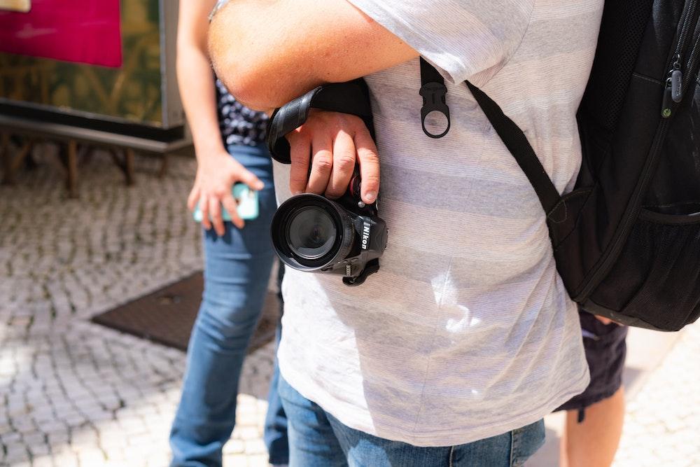 People taking photos on Rua de Bica in Bairro Alto, Lisbon, Portugal