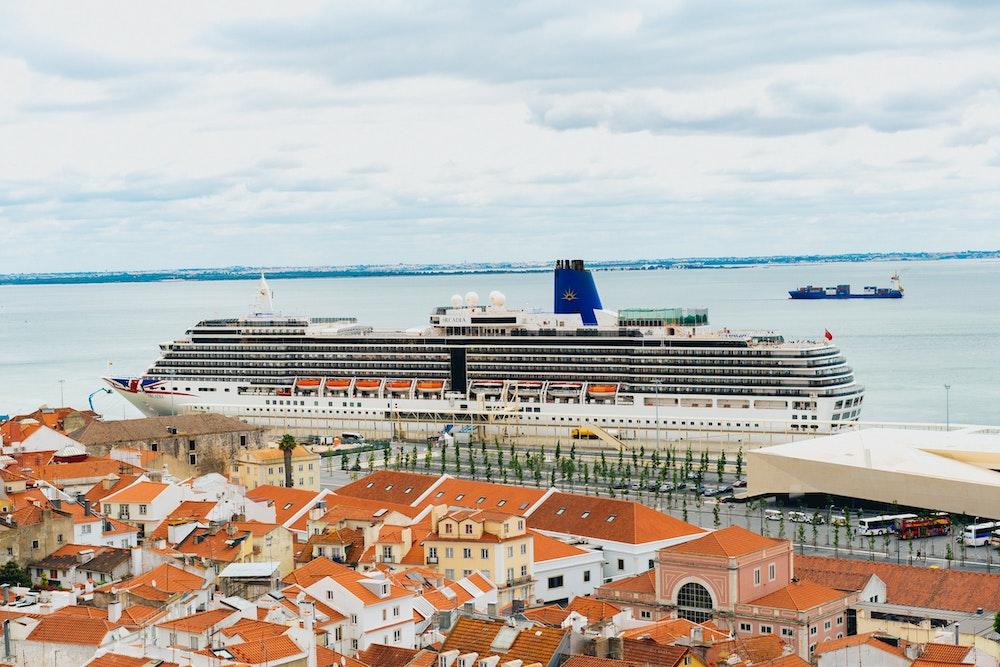 View of a cruise ship from Miraduoro de Santa Luiza in Lisbon, Portugal's Alfama district