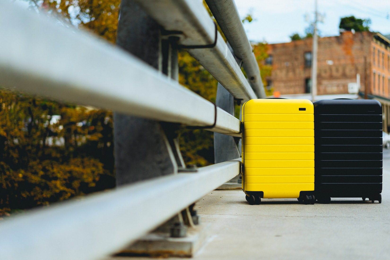 Yellow and black suitcase in an urban setting