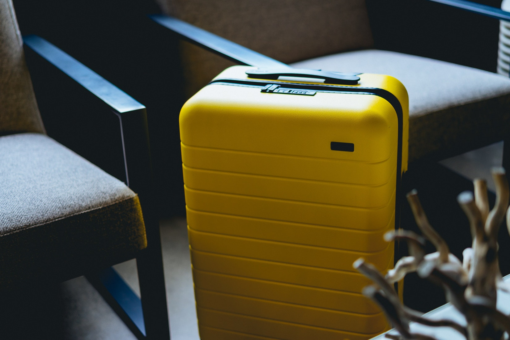 Yellow luggage at a hotel