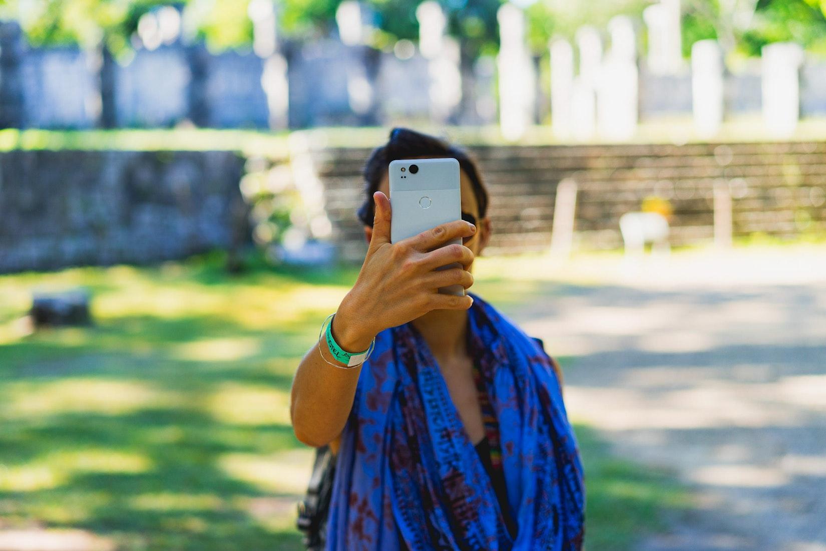 Girl holding a Google Pixel 2 P