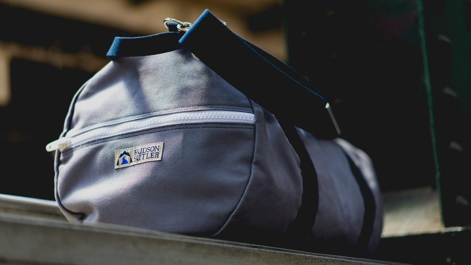 Hudson Sutler duffle bag at a train station