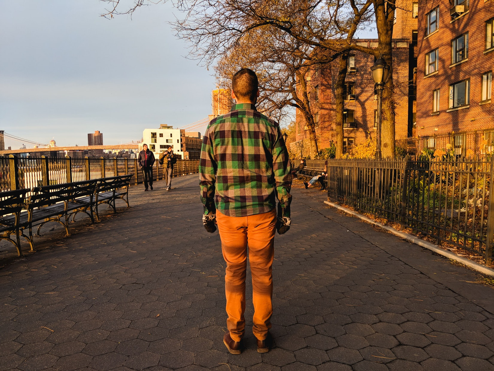 Back of a man wearing a gingham flannel shirt from UNTUCKit