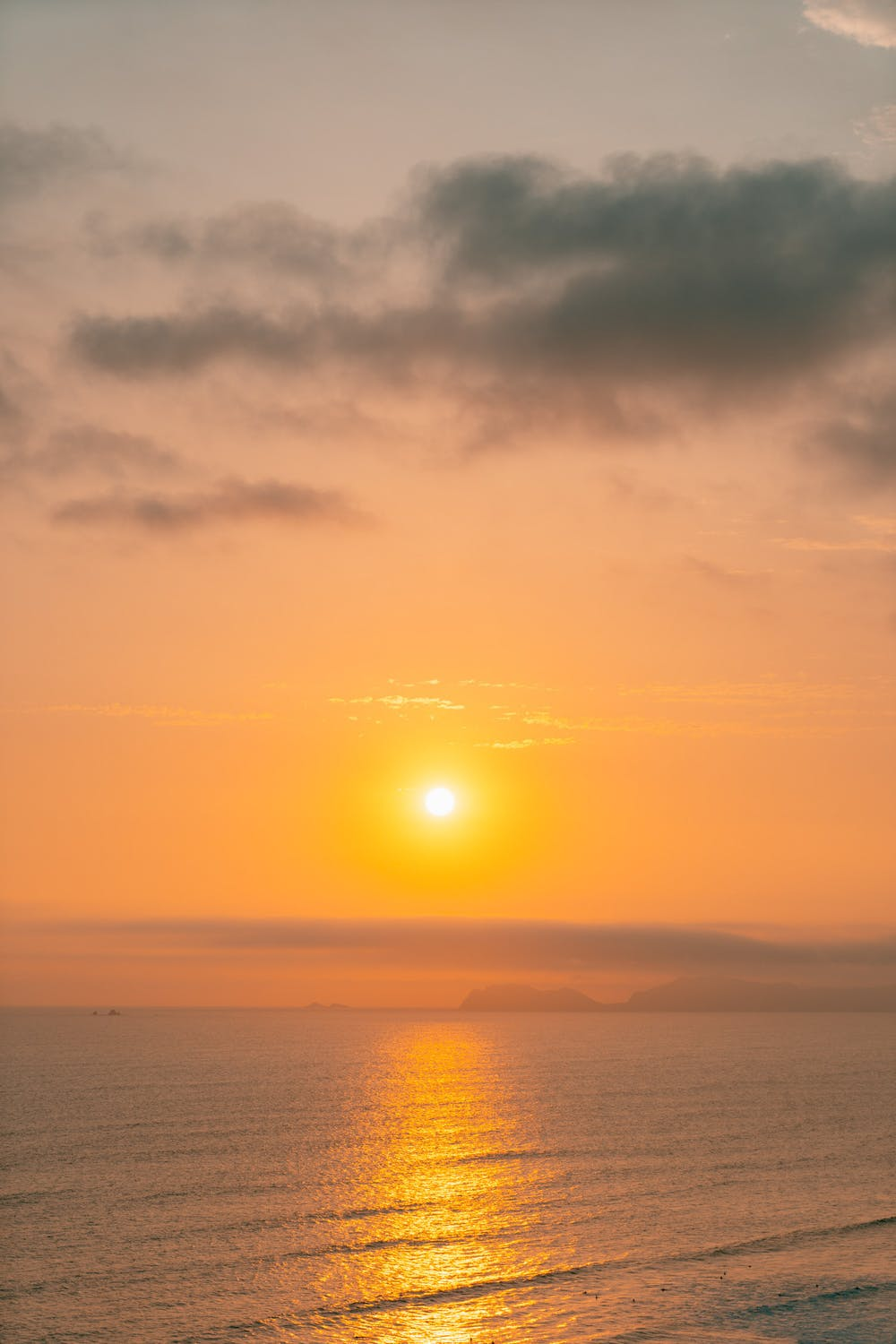 Bright yellow sunset on the water from Lima, Peru