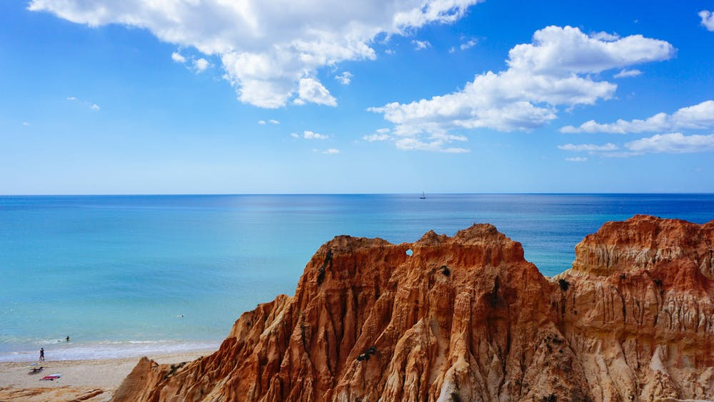 Beach and red rocks off the south coast of Portugal