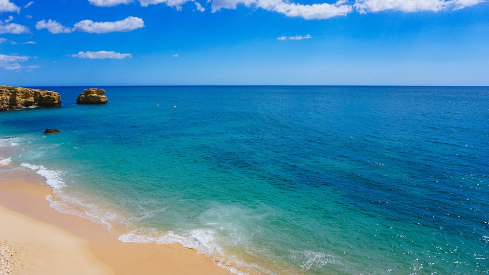 Bright blue water from a beach in Portugal