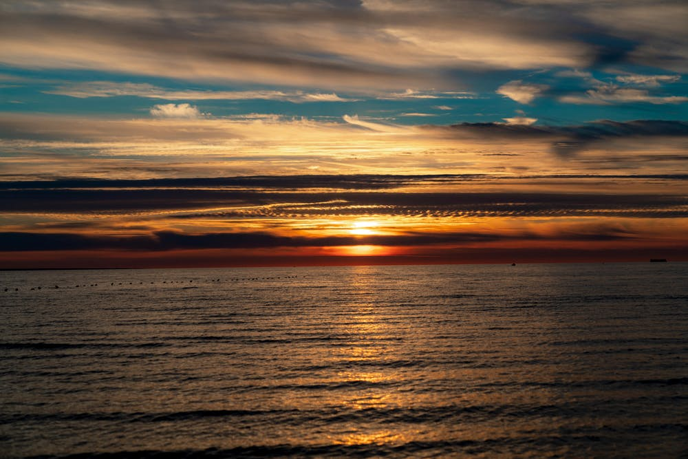 Dark and colorful sunset with long cloud bands
