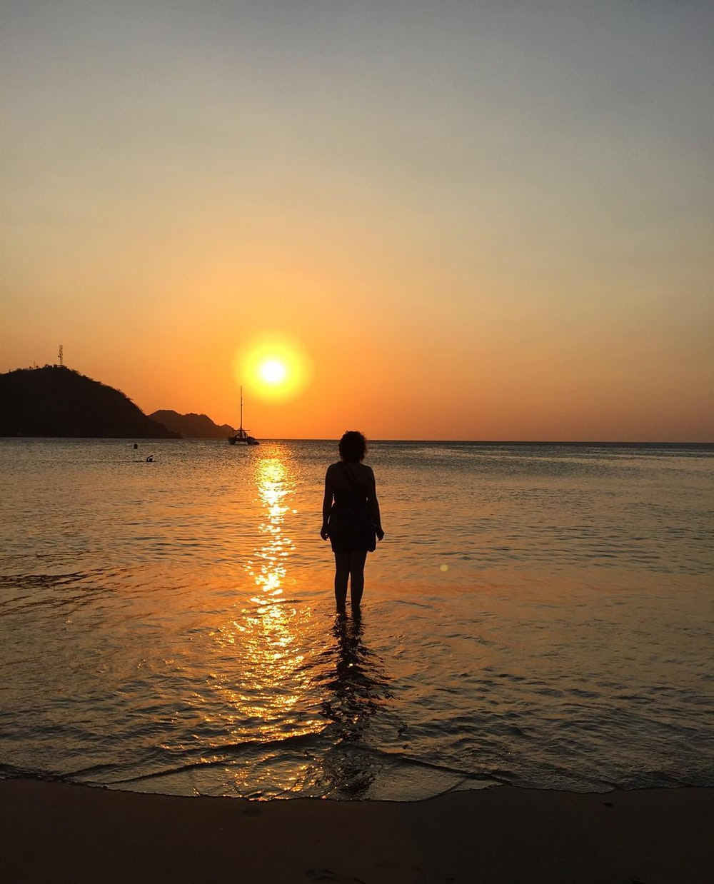 Wading into the Caribbean Sea in Taganga, Colombia