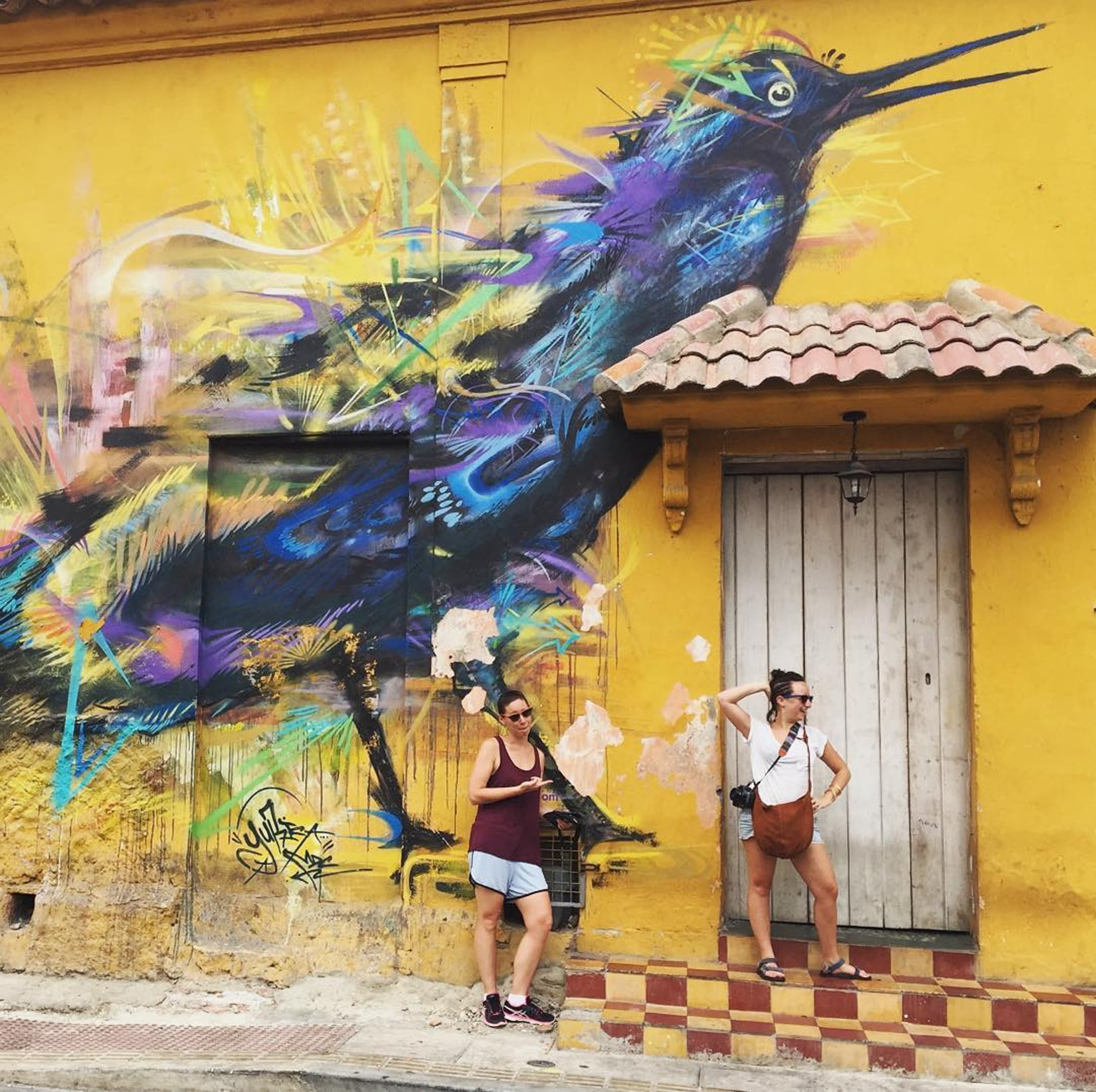 Photo of Becca and a new friend during a graffiti tour through Cartagena, Colombia.