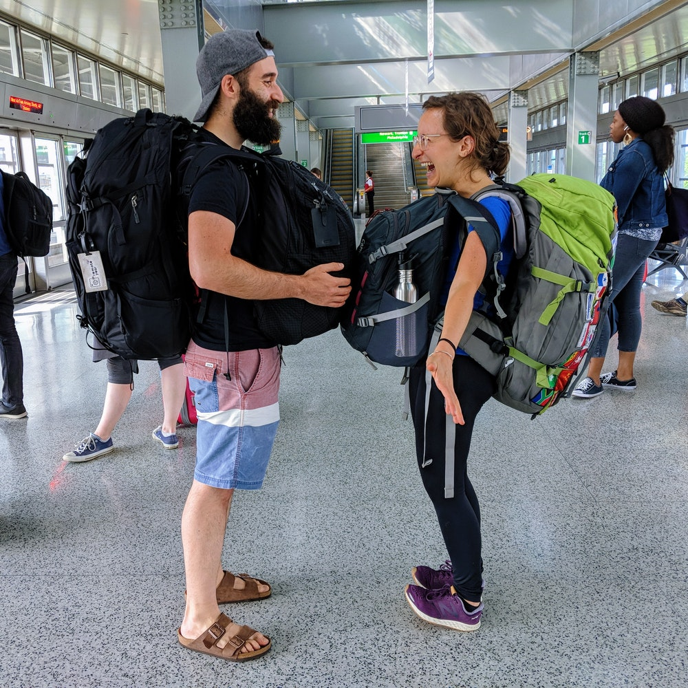 Becca and Dan with backpacks ready for a flight
