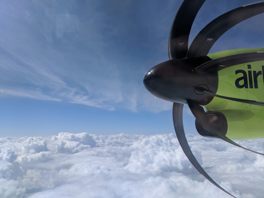 Airplane propeller above the clouds