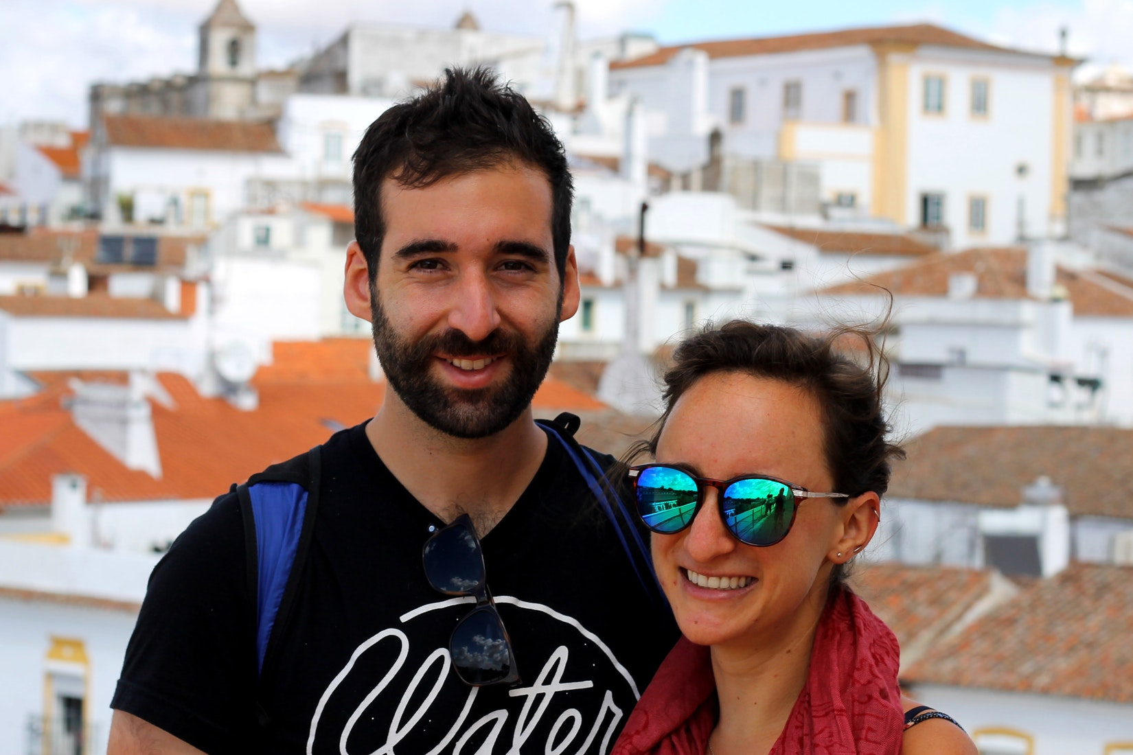 Boyfriend and girlfriend smiling for a photo in Evora, Portugal