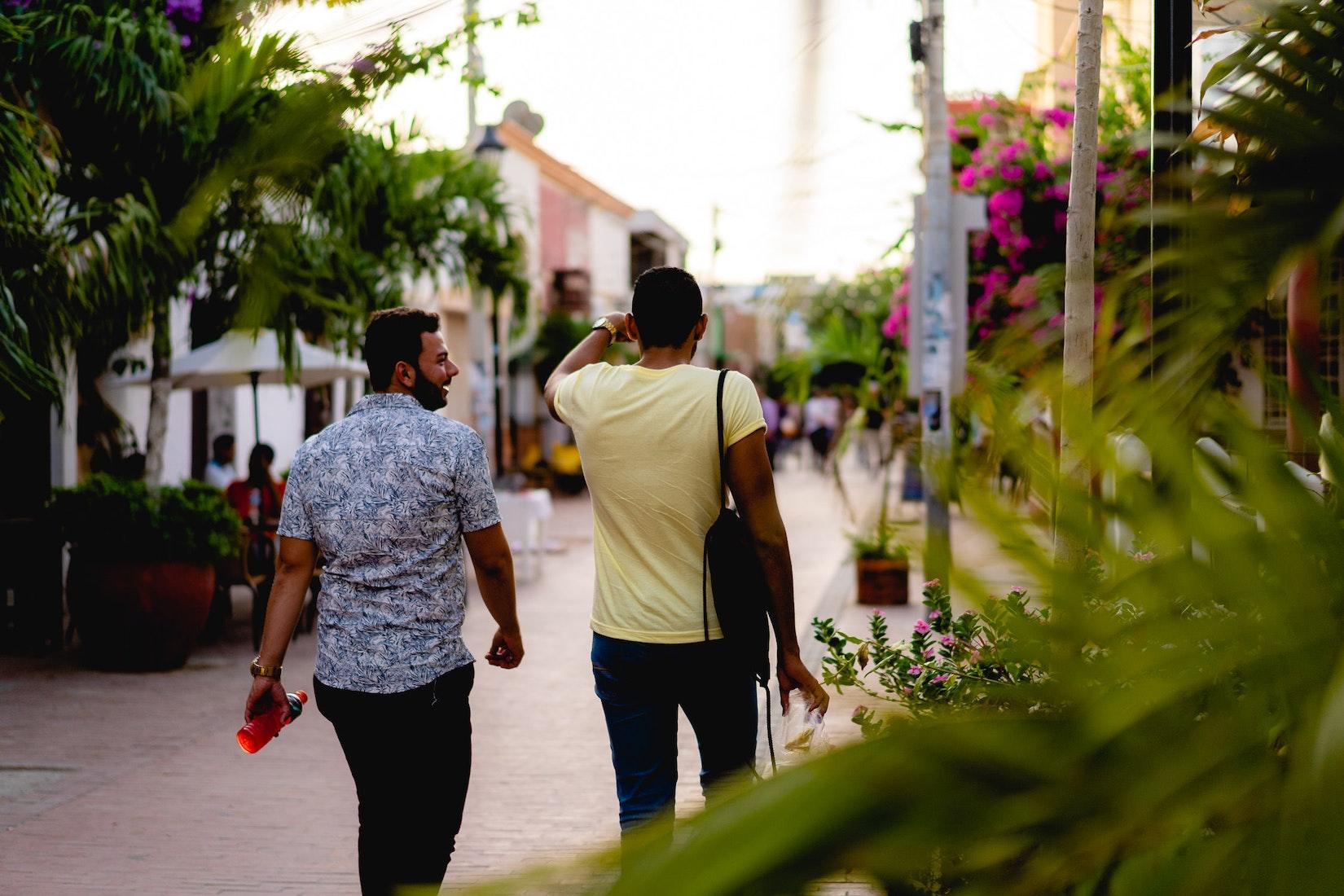 Two guys walking down a street in Santa Marta