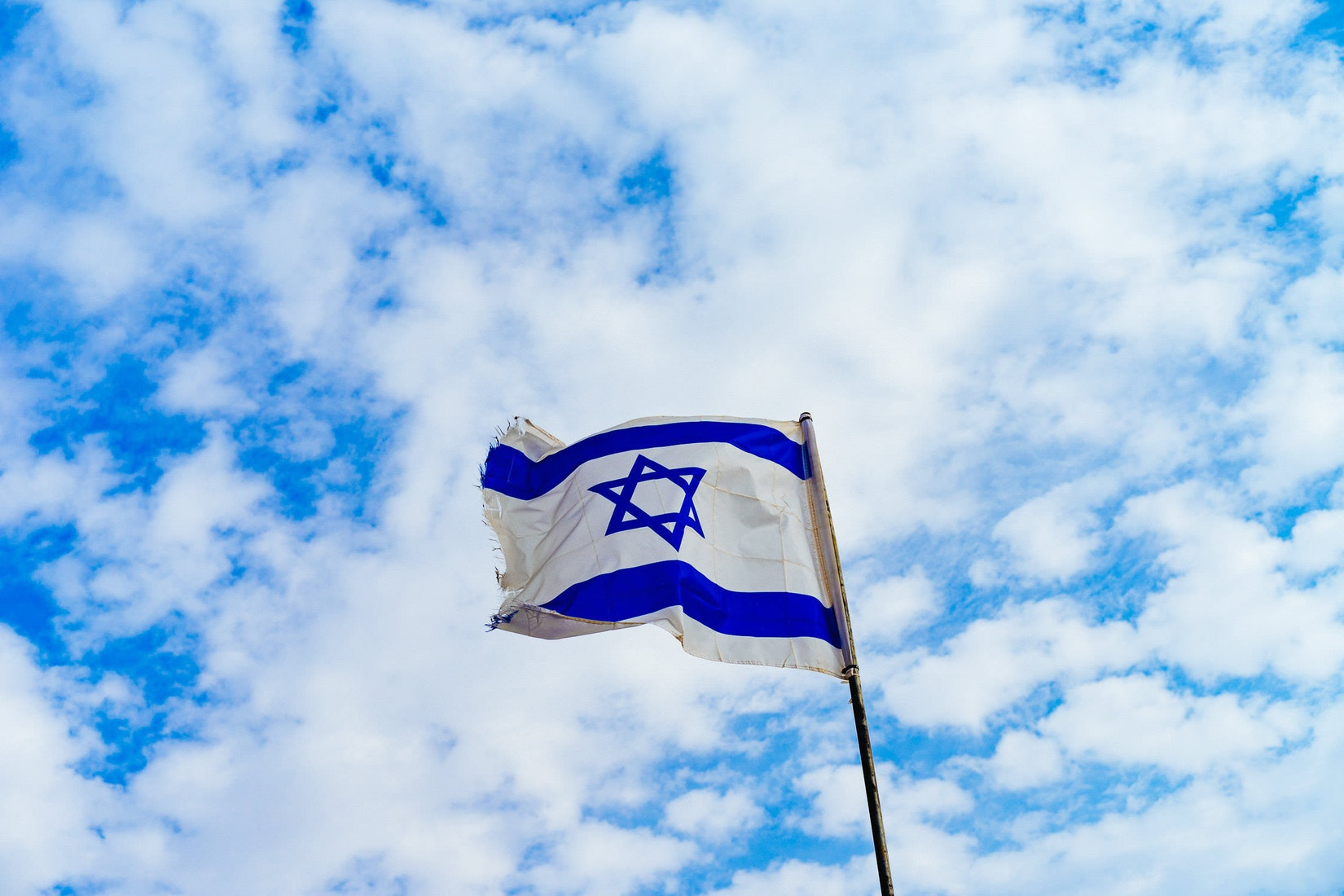Israel flag on a blue sky