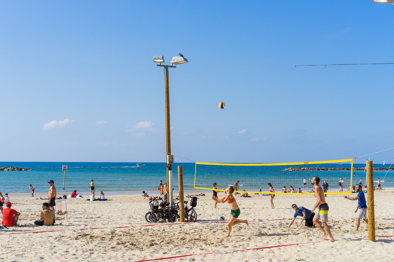 People playing volleyball at a beach in Tel Aviv