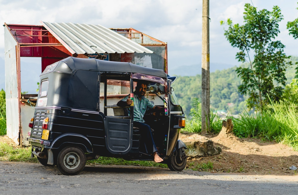 Man with a tuk-tuk in Sri Lanka