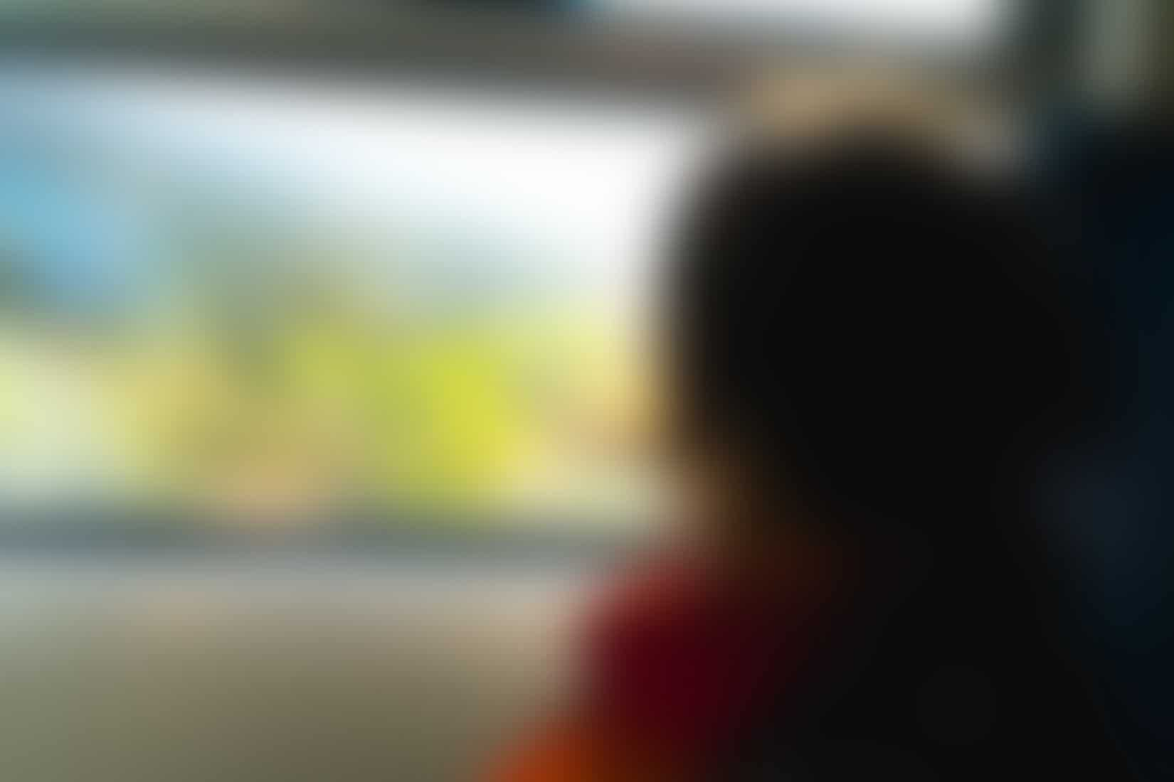 Girl looking out the window of a train
