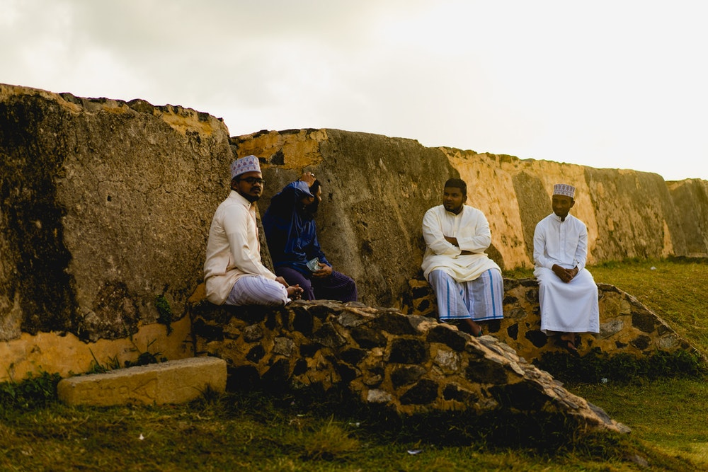 4 men on the wall of Galle for during sunset