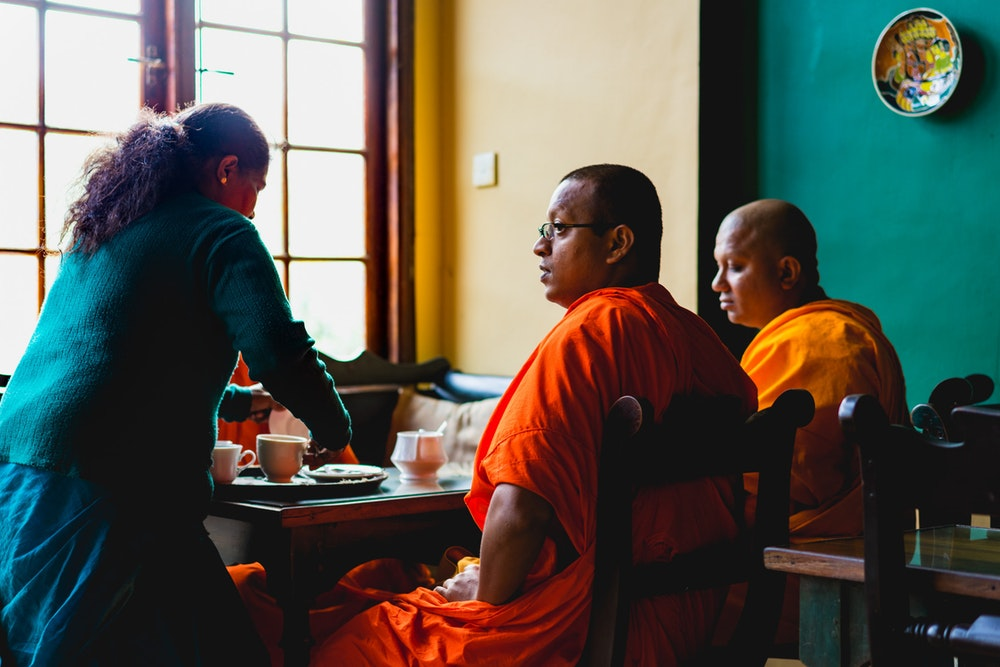 Monks being served tea